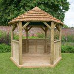 3m Premium Hexagonal Wooden Garden Gazebo with Thatched Roof – Green Lining – Installed